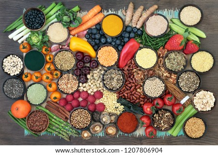 Liver detox super food with fruit, vegetables, herbs, spices,legumes, nuts, seeds, grains, cereals and herbal medicine. Health foods high in antioxidants, vitamins  & fibre.  Top view on bamboo & oak. Stock photo ©