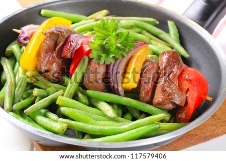 Liver skewer with green beans  - stock photo
