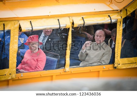LIVERPOOL, ENGLAND - MAY 17: Her Royal Highness Queen Elizabeth II and the Duke of Edinburgh on the Yellow Duckmarine in Liverpool during the Diamond Jubilee tour, Liverpool, England. May 17, 2012