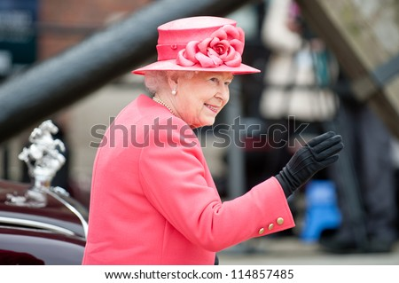 LIVERPOOL, ENGLAND - MAY 17 2012: Her Royal Highness Queen Elizabeth II visits Liverpool Albert Dock during her Diamond Jubilee tour of Great Britain, Liverpool, England. May 17 2012