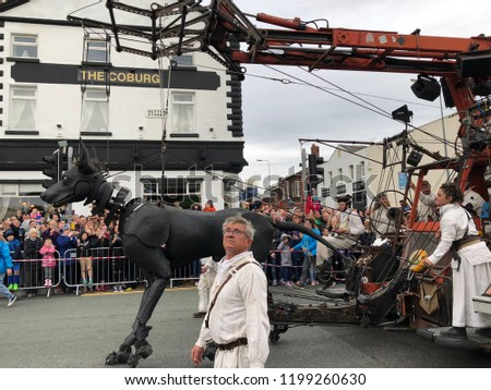 Liverpool, Merseyside, UK. October 7th 2018. The giant Royal De Luxe street puppets make a final appearance at Liverpools waterfront, Liverpool, Merseyside, UK #1199260630