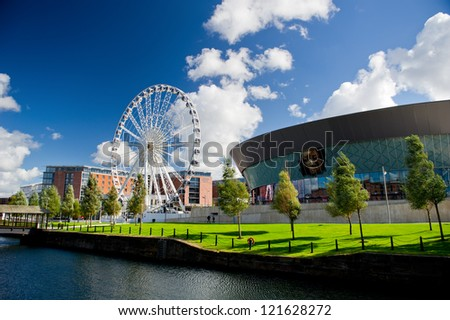LIVERPOOL - SEP 19: Liverpool Wheel and Echo Arena on September 19, 2012 in Liverpool, England, United Kingdom. The 60-metre wheel is positioned on the piazza outside the city�s ECHO arena.