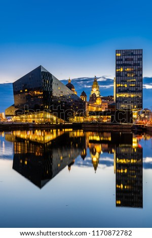 Liverpool Skyline building at Pier head and alber dock at sunset dusk, Liverpool England UK.