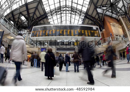 Liverpool street station in the UK at rush hour. Fisheye lens, all faces blurred out and logos/trademarks removed
