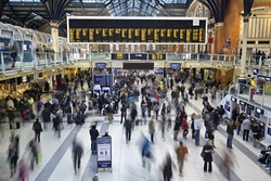 Liverpool street station in the UK at rush hour with all faces blurred out and logos/trademarks removed