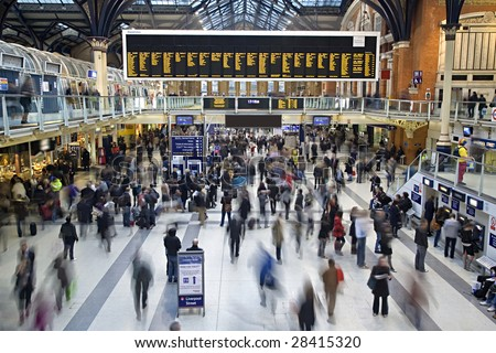 Liverpool street station in the UK at rush hour with all faces blurred out and logos/trademarks removed - stock photo