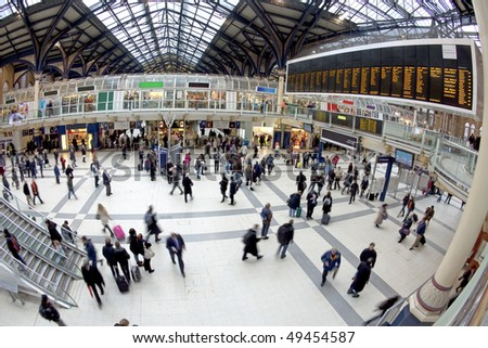 Liverpool street station in the UK. Fisheye lens, all faces blurred out and logos/trademarks removed