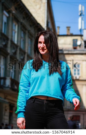 4b1b1044c547f Livestyle portrait of a brunette girl in a blue dwarf toe on the streets of  the