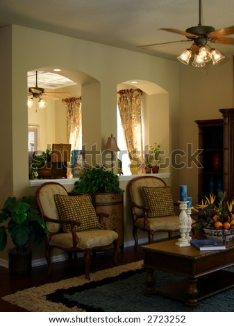 living area in upscale home with arched room dividers