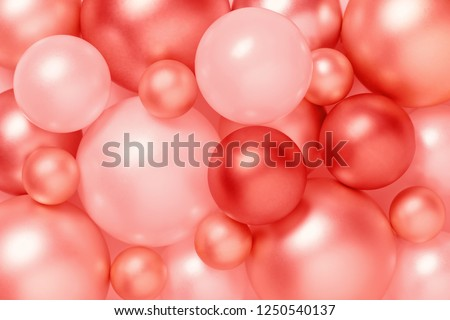 Living coral color background of metallic Christmas balls, trendy composition, color of the 2019 year