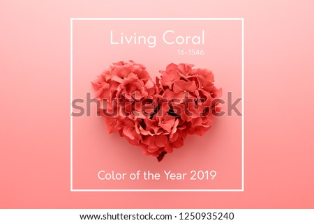 Living Coral color of the Year 2019 inscription. Heart shape made of flowers, abstract background. Gradient colors palette.