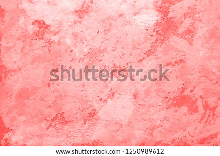 Living Coral color of the Year 2019 on abstract background or decorative texture of old stucco wall, plaster. Home decor. #1250989612