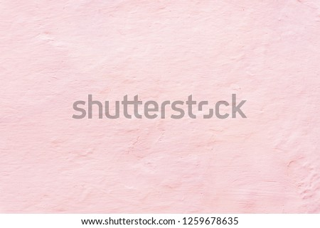 Living coral color textured background, whitewashed wall with color toning.
