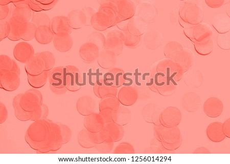 Living Coral pastel confetti and sparkles background, golden stars. Bright and festive. Color of the year 2019 16-1546. Copyspace for text.