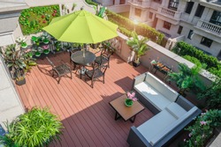 Living Garden balcony with tables and chairs