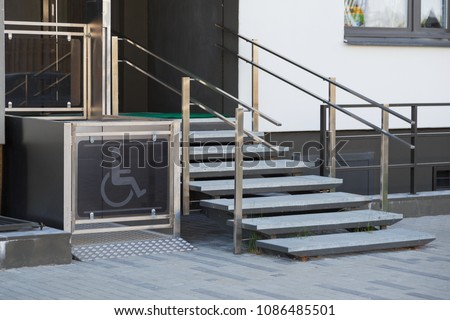 Living house entrance equipped with special lifting platform for wheelchair users #1086485501