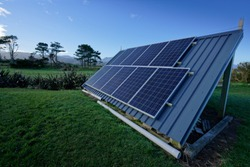 Living off the grid. Solar panels providing electricity to an off grid house in New Zealand's back country.