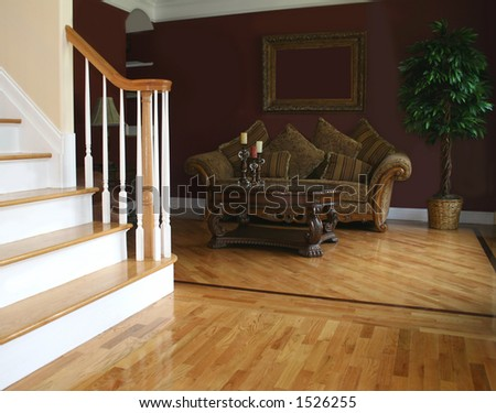 Living room as seen from foyer; blank space in picture frame - stock photo