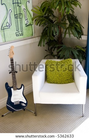 Living room chair and electric guitar