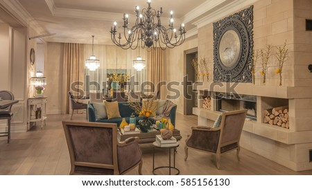 Living room decorated with flower the style of Provence in cream color with beige curtains, light parquet flooring, two armchairs, white console, three chandeliers, iron clock