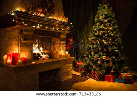 Living room home interior with decorated fireplace and christmas tree #713433166