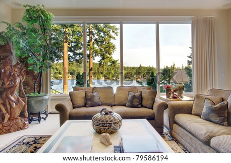 Living Room  in Luxurious New Home with View of Lake