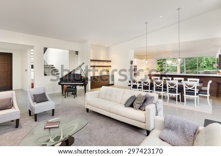 Living Room in Luxury Home with Wide Open Floor Plan, View of Kitchen, Piano, Entry, Wet Bar, Dining Table #297423170