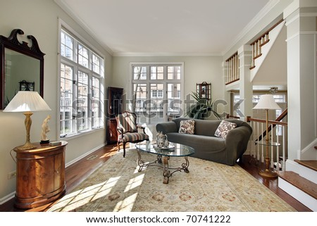 Living room in modern townhouse with foyer view