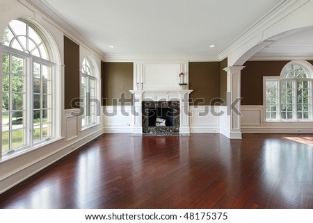 Living room in new construction home with cherry wood flooring