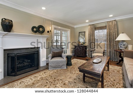 Living Room In Upscale Home With Fireplace