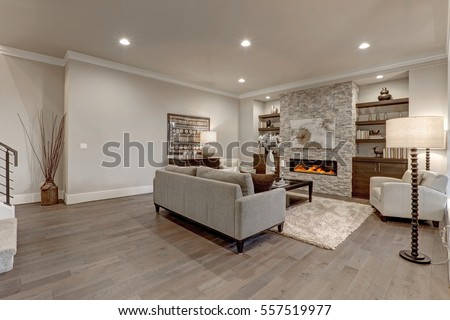 living room interior in gray and brown colors features gray sofa atop dark hardwood floors facing - Grey And Brown Living Room