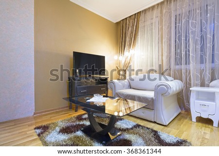 Living room interior in the evening