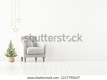 Living room interior wall mock up with grey tufted armchair, fur pillow and decorated christmas tree on empty white background. 3D rendering.