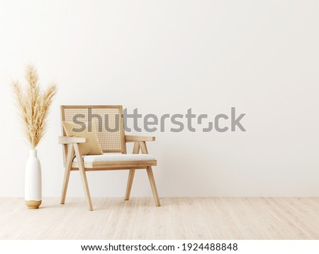 Living room interior wall mockup in minimalist Japandi style with caned chair, beige pillow and dried pampas grass in ceramic vase on empty warm white background. 3d rendering, 3d illustration.