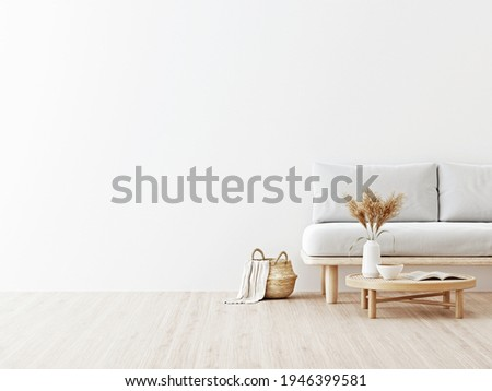 Living room interior wall mockup in warm neutrals with low sofa, dried Pampas grass on caned table and japandi style decoration on empty white wall background. 3D rendering, illustration.