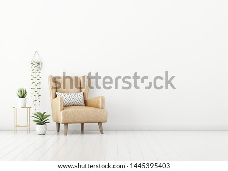 Living room interior wall mockup with tan brown leather armchair, pillow, coffee table and green plants in pots and hanger on empty white wall background. 3D rendering, illustration.