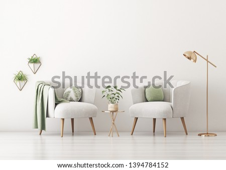 Living room interior wall mockup with two gray armchairs, round pillow with tropical pattern, green plaid, lamp, coffee table and plants on empty white wall background. 3D rendering, illustration.