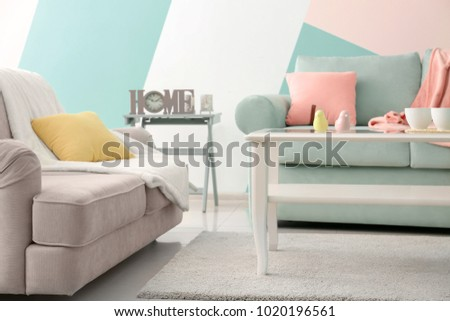 Living room interior with comfortable couches and table
