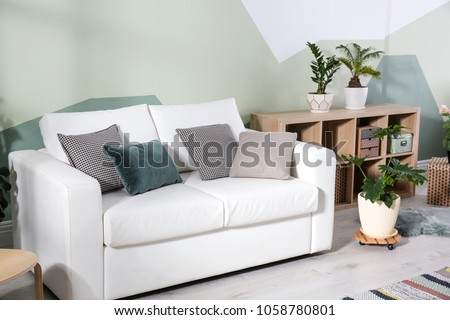 Living room interior with comfortable sofa #1058780801