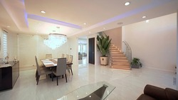 Living room interior with dining table. Beige color prevails.