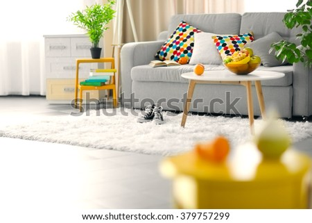 Living room interior with sofa and table