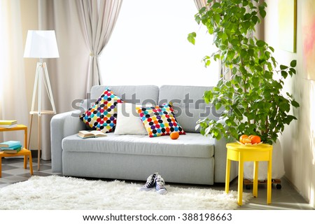 Living room interior with sofa, lamp and green tree #388198663
