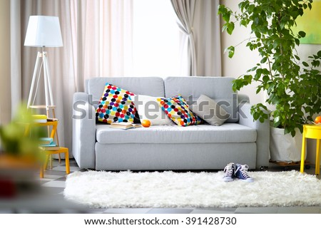 Living room interior with sofa, lamp and green tree #391428730