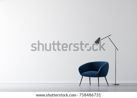 Living room interior with white walls, a concrete floor and a dark blue armchair standing near a lamp. 3d rendering mock up