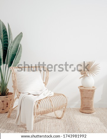 Living room interior with wicker armchair and flower, white wall mock up background, 3D render