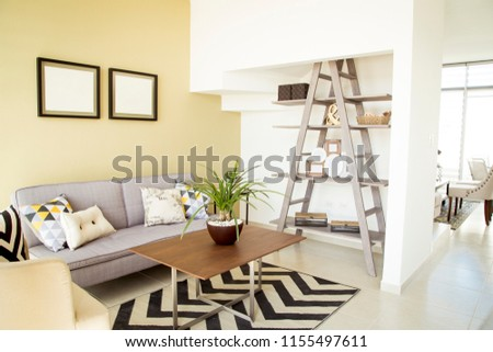 Living room of new house with purple sofa and decorations #1155497611