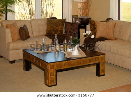 Living Room Setting With Couch And Coffee Table Done In Earth ...