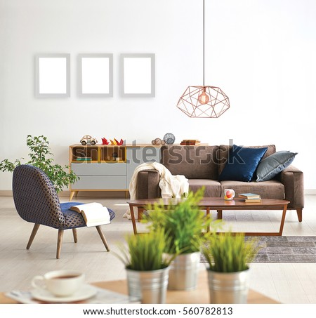 living room sofa and armchair with vase of grass, modern lamp, frame #560782813