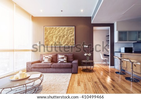 living room with big window interior. Big picture on brown wall