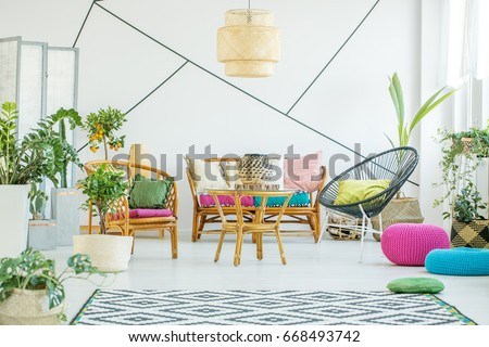 Living room with colorful poufs, plants and decorative tape on the wall #668493742